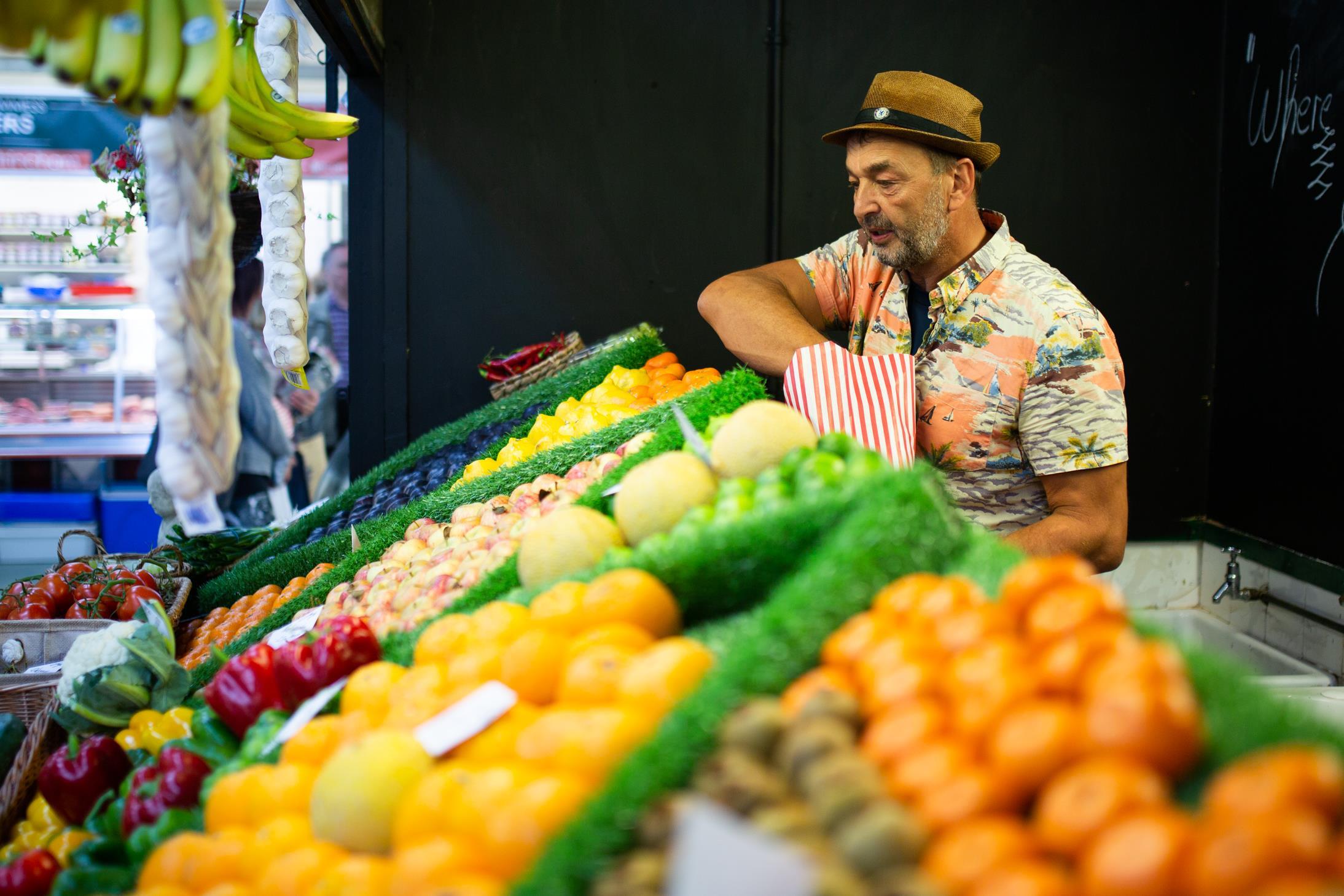 Market Trader bagging fruit