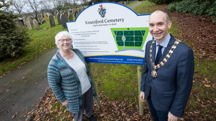 Cllr Jan Nicholson and Cllr Andrew Malloy stood near the sign to Knutsford Cemetery