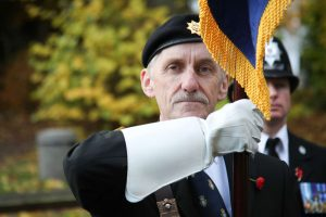 A man holds the RBL standard