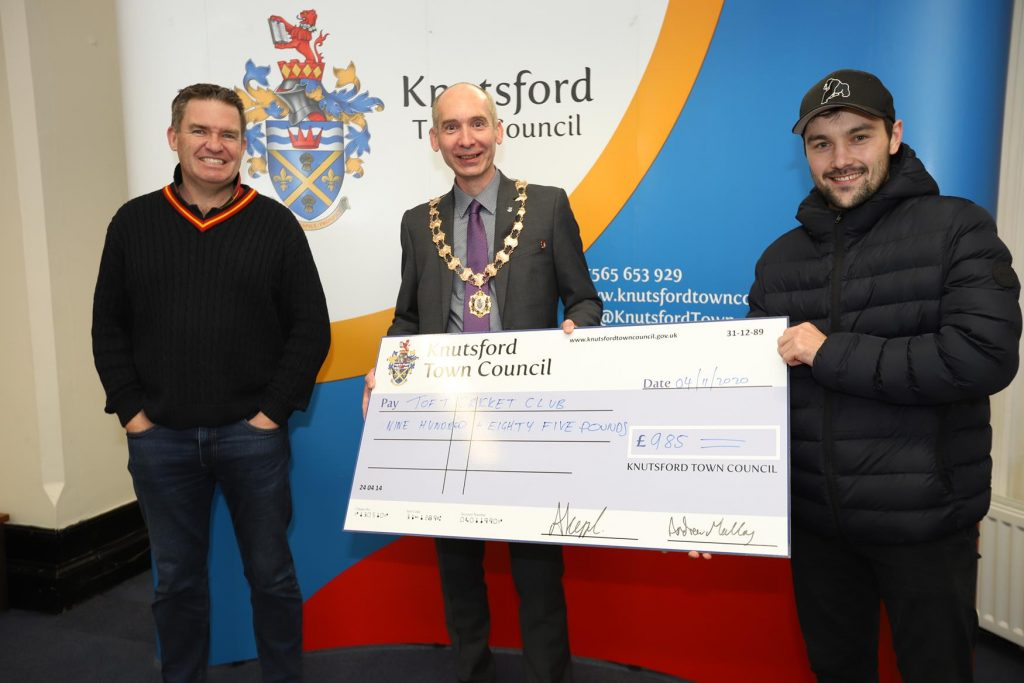 Toft Cricket Club receive a cheque from the Town Mayor