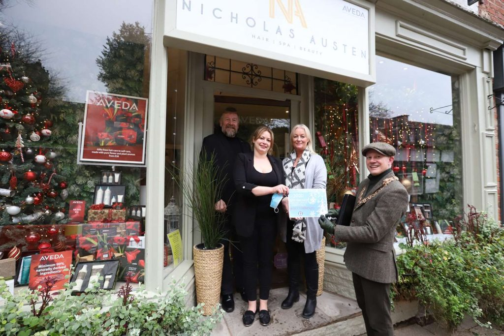 Mayor Presents Certificate for Christmas Window Competition to Nicolas Austen
