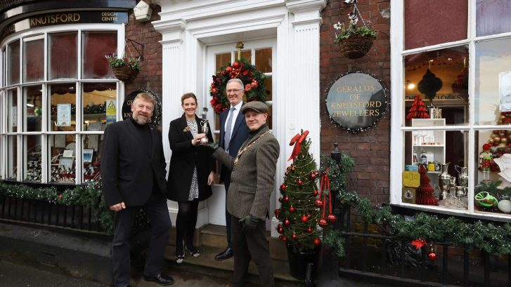 Mayor Presents Certificate for Christmas Window Competition to Geralds of Knutsford