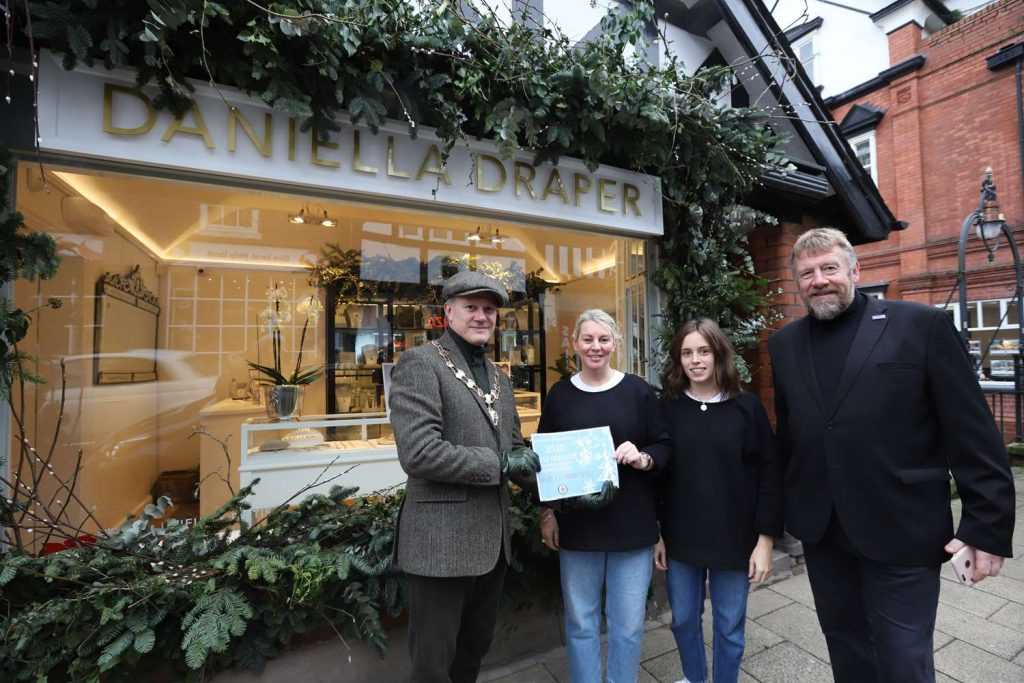Mayor Presents Certificate for Christmas Window Competition to Daniella Draper