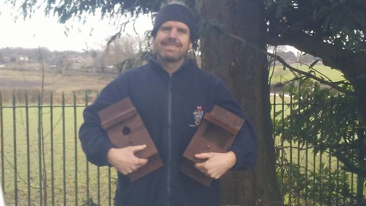 Town Ranger Bob Garner holding two bird boxes