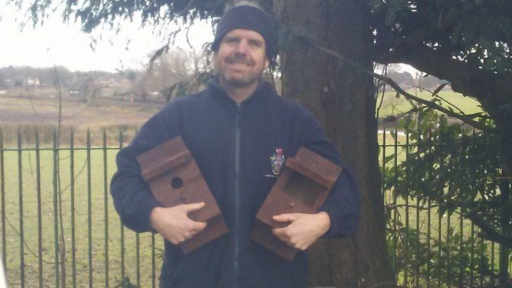 Town Ranger Bob Garner holding two bird boxes