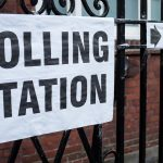 A photo of a polling station sign