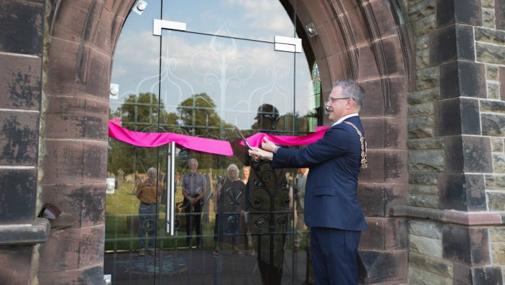 Town Mayor cuts a ribbon to open the cemetery chapel