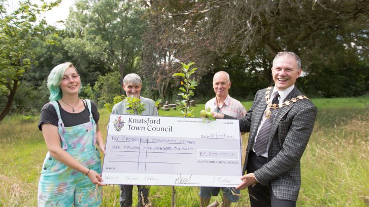 Town Mayor presents cheque to the Crosstown Community Orchard