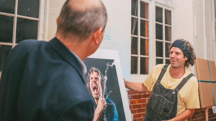 Town Ranger Bob Garner looks at his portrait