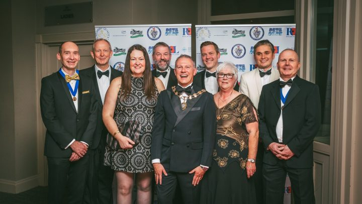 A group of people in black tie with the Town Mayor front centre